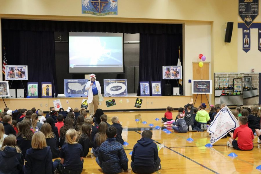Lower+School+principal%2C+Chris+Hydock%2C+tells+his+students+about+the+BoosterThon+Run+in+chapel.+
