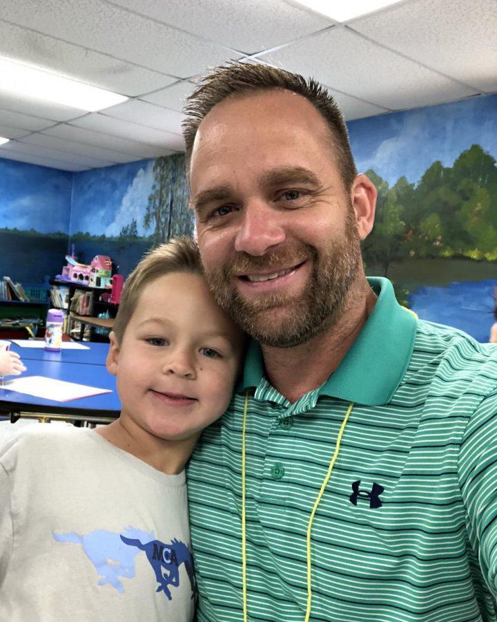 Blake Cheatham, Pre-K, smiles at the camera with his dad, Kory Cheatham.