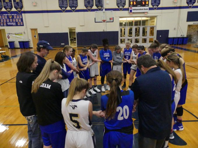 After a tough match against Dallas Thunder, the teams come together to pray.