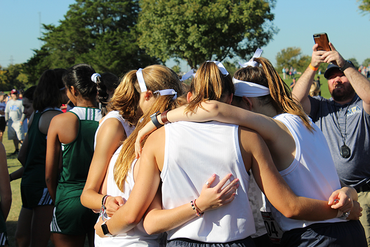 Before the gun shoots to signal the start of the race, the Varsity Girls group up to pray.