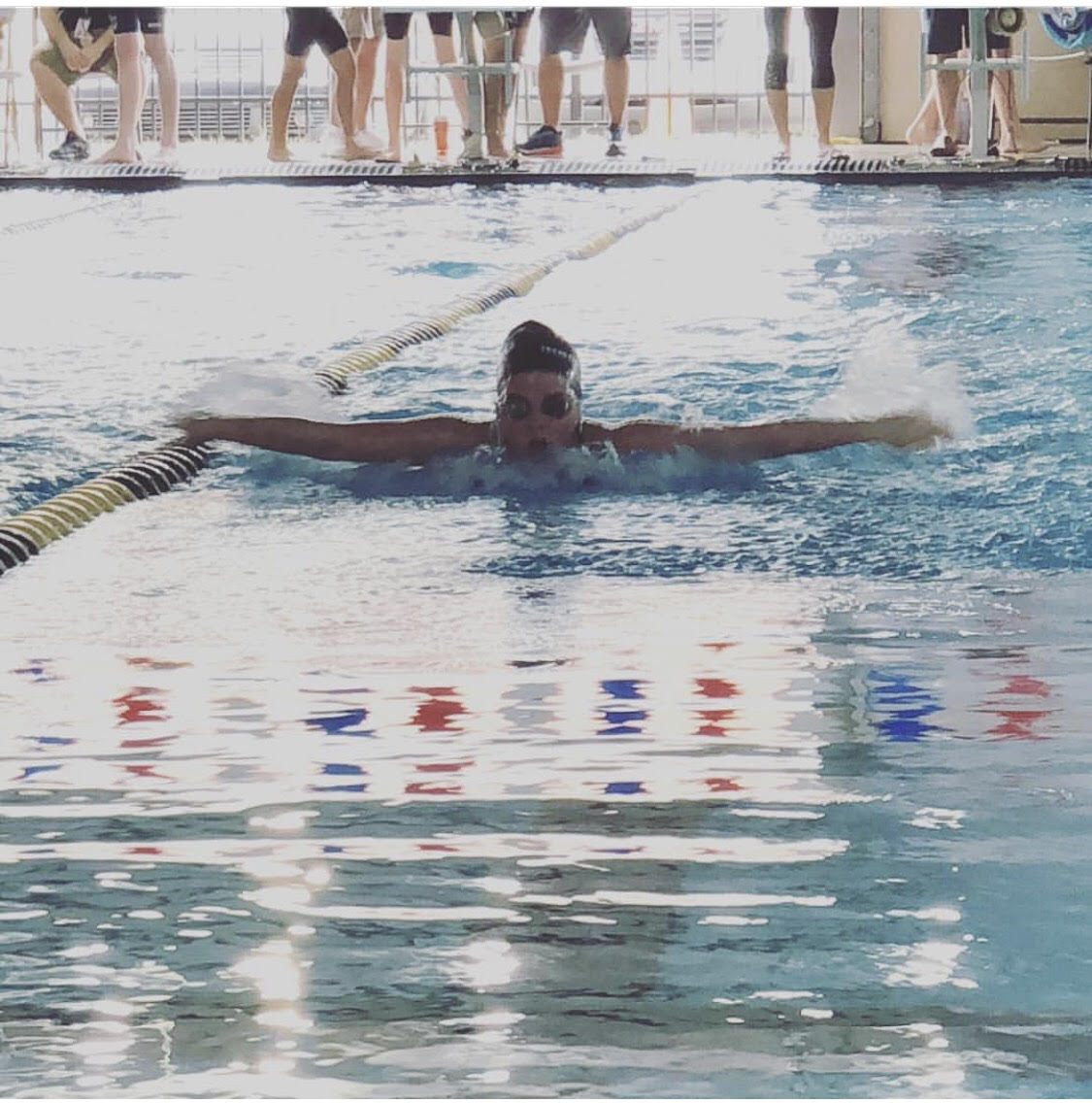 Freshman Peyton Baker competes in the butterfly race.