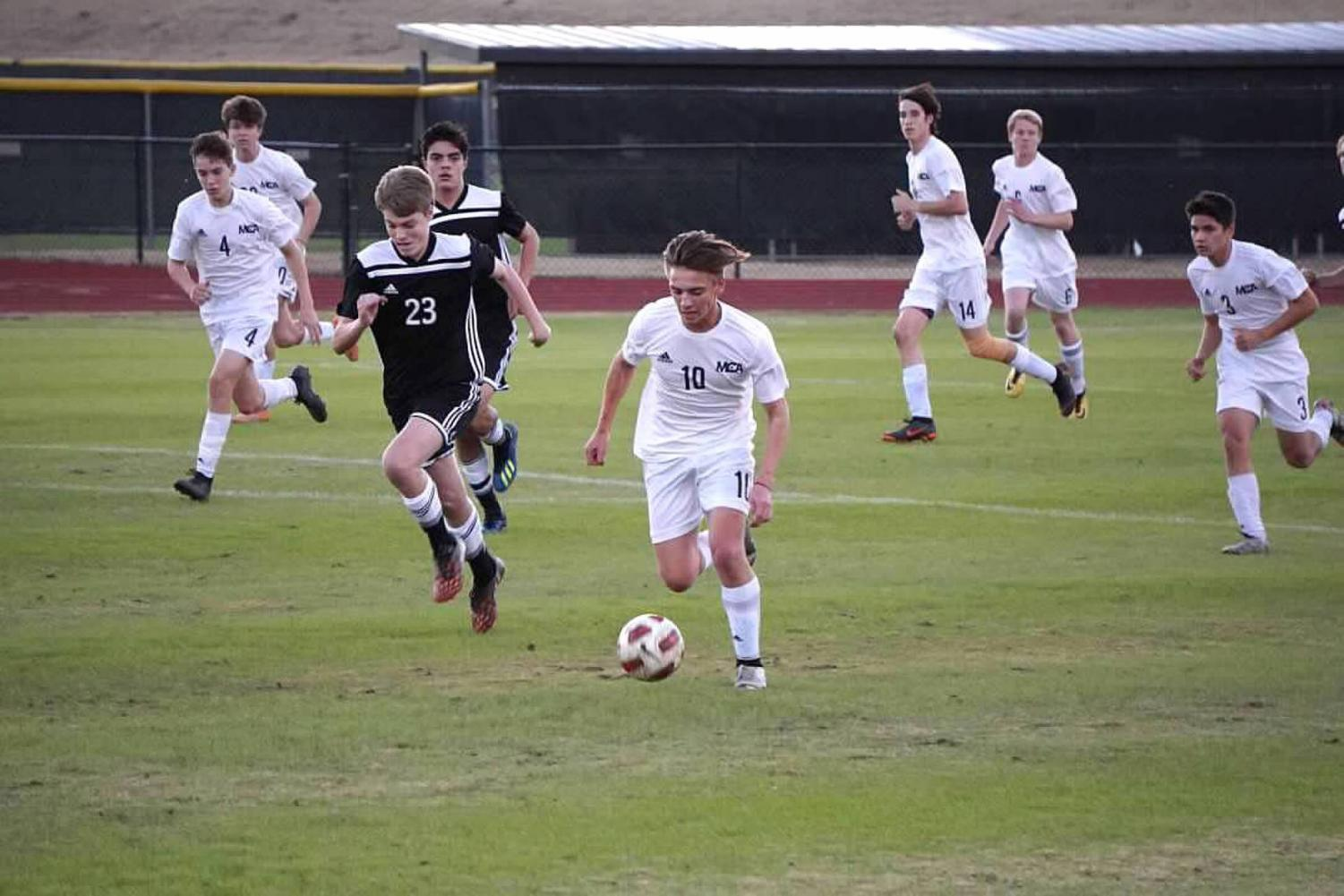 Senior Syler Gabel picks the ball off from a bad pass from the opposing team. Most games with the Mustangs are a constant back and forth struggle, and good midfielders like Syler prevent this from happening.