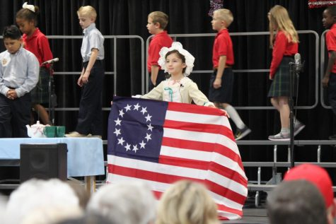 Third Grader Bella Tucker played the role of Betsy Ross in the Grandparents Day program.
