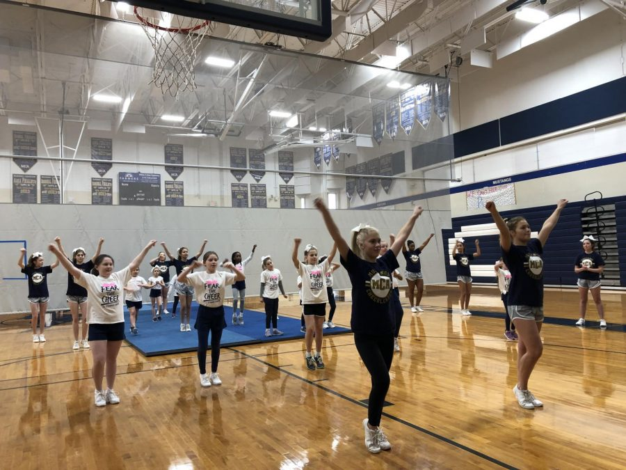 Varsity Cheer Squad teaching the new cheer to the 2nd through 5th graders.
