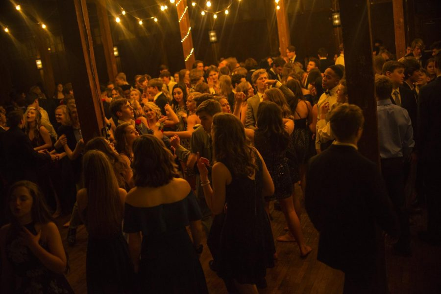 The+Upper+School+students+taking+on+the+dance+floor+at+Winter+Formal.+