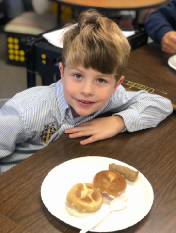MCA's kindergarteners and first graders have a fun day filled with activities  celebrating the 100th Day of School. This is a picture of first grader Aiden Schweizer eating his special breakfast provided by his teacher.