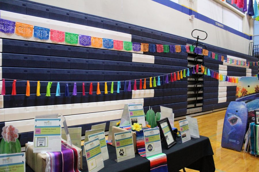 Fiesta themed decor was strung throughout the gym and around silent auction tables.