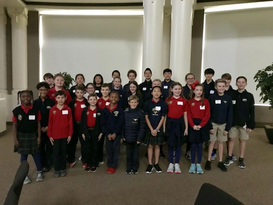 Third through eighth graders pose for a picture after the ACSI Math Olympics competition.