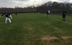 At the beginning of practice, the team warms up together by playing catch.