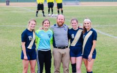 Seniors, Kate Witte, Elyse Mead, Juliana Roller and Emma Thompson pose for a picture with head coach, Tyler Ferguson, after being showcased.