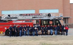 The Teen CERT class gathers in front of a visiting fire truck for a picture. Firemen and paramedics from Station 2 visited MCA to teach the Teen CERT class emergency first aid and how to properly care for the injured.