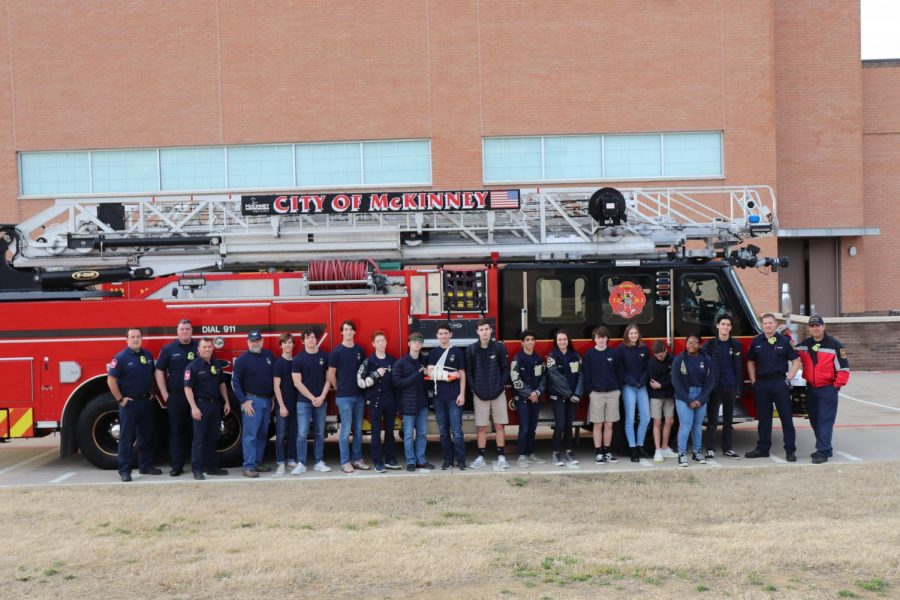 The+Teen+CERT+class+gathers+in+front+of+a+visiting+fire+truck+for+a+picture.+Firemen+and+paramedics+from+Station+2+visited+MCA+to+teach+the+Teen+CERT+class+emergency+first+aid+and+how+to+properly+care+for+the+injured.