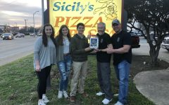 During the fundraiser at Sicily's last night, senior NHS officers Emma Lowes, Juliana Roller, and Josh Wong presented Officer Hamilton's father with the money the MCA students raised.