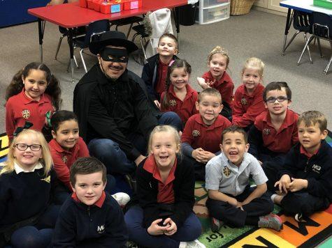MCA's Zero Hero spending time with the students.
