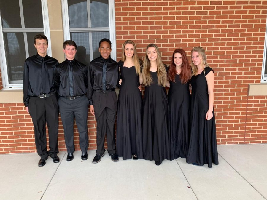 MCA ensemble members smile for a picture after their competition.