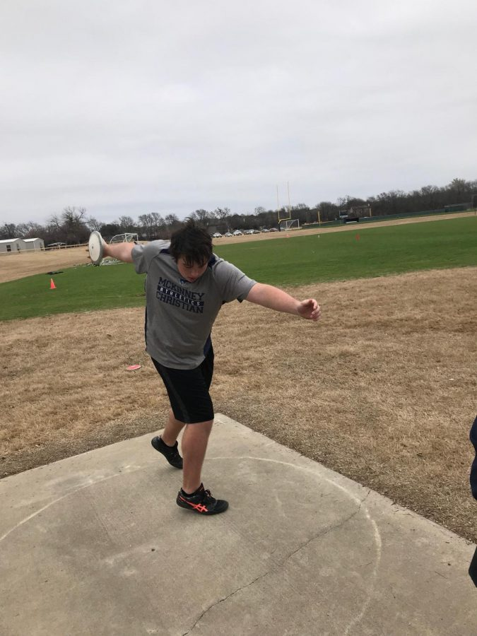 Senior Josh Pawlish practices throwing discus while at track practice.