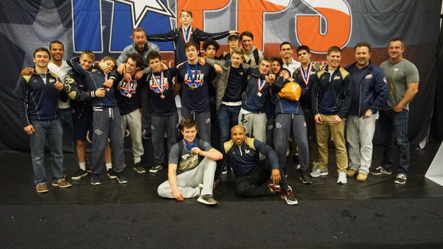 The+Mustang+wrestlers+pose+for+a+photo+after+getting+fourth+place+at+TAPPS+State.