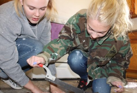 Meg Boone And Aby Beck work on refurbishing a home.