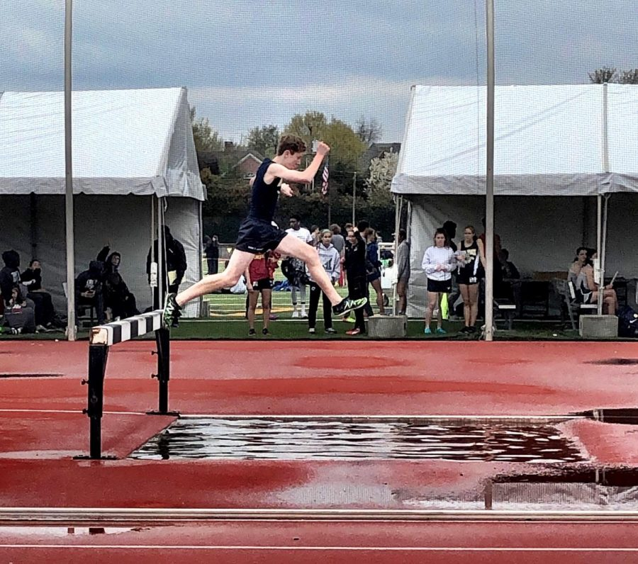 Leaping over the hurdle during the 2000m steeplechase, sophomore Aiden McKeller beat his older brother, senior Everett McKeller's, previous time for this event.