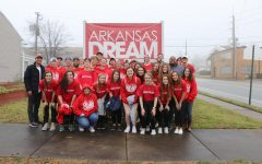 The Arkansas Mission team posed for picture in front of the Dream Center sign after helping them for five days.