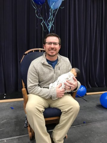 Middle school teacher and coach Brady James gets surprised last week at the middle school chapel.  They showered him with baby gifts and fun games.