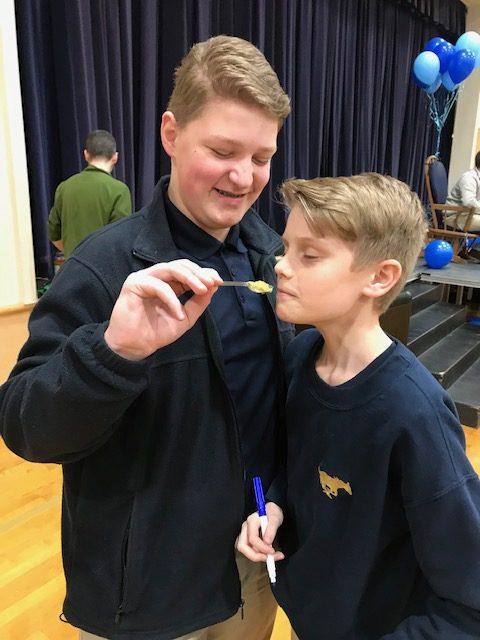Seventh graders Jackson Iseneker and Luke Golle taste test baby food at the baby shower.