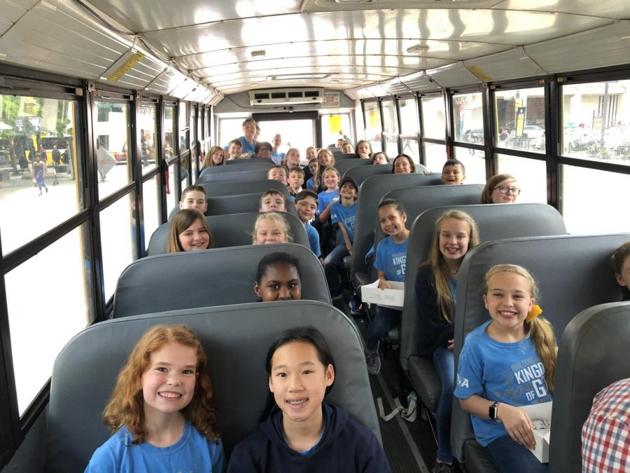 5th grade students smile for a quick photo before leaving for the museums.