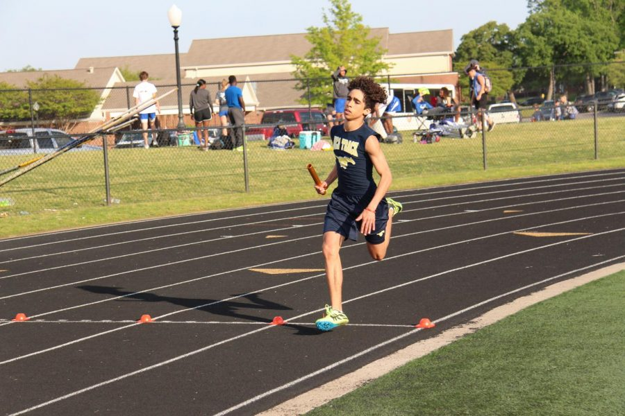 Anchor of the 4x400m race, sophomore Maliq Brock finishes the relay race placing second, moving the team on to Regionals.