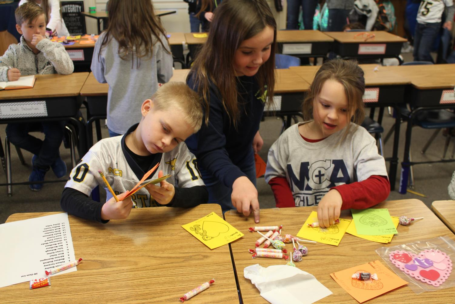 Braxton Beazley, River Gabel and Valesca Cormney gather together to work on Val-O-Grams for friends.