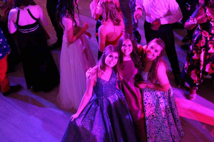 Juniors Maddie Gwyn, Lauren Jones, and Allie Smith smile for a picture before they started dancing.