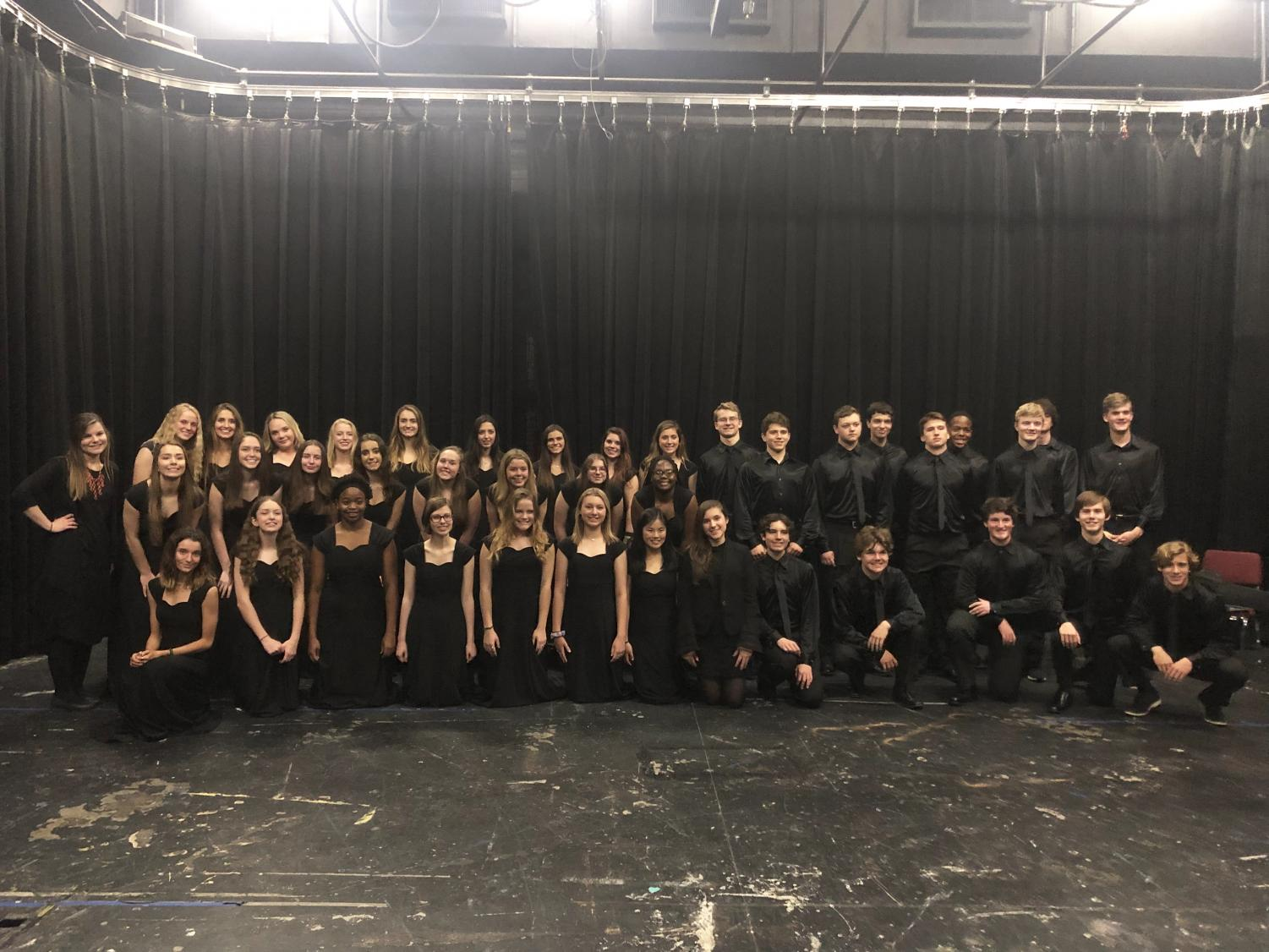 The Upper School Mixed Choir poses for a picture after they performed.