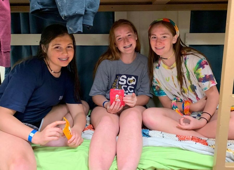 Lauren Etheredge, Lauren Jackson, and Ava Thompson smile for picture while talking in the bunks.