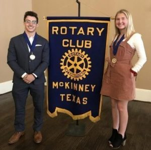 Seniors Graham Kraft and Scout Mayberry are honored at the McKinney Rotary Club spring meeting.