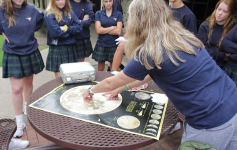 Middle School Science Teacher Exhibits Samples From Space