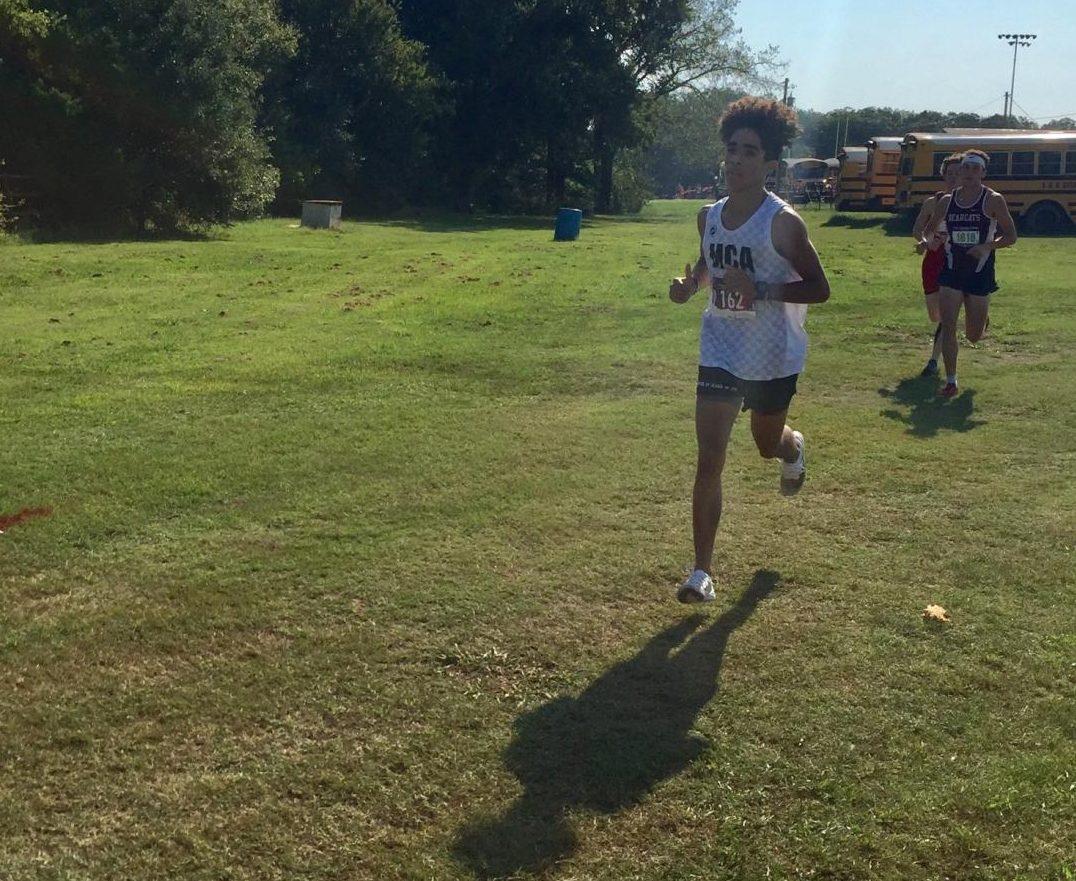 Junior, Maliq Brock runs early Saturday morning in the meet.