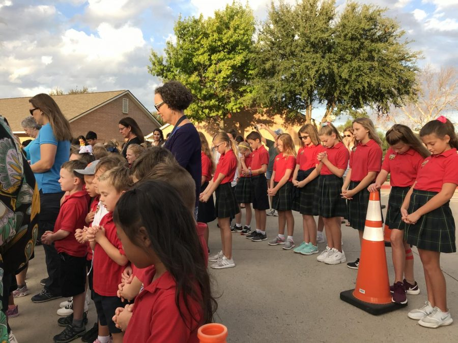 Lower School students praying at