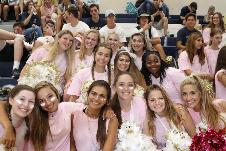 Senior girls take a group picture during the volleyball game on Friday.