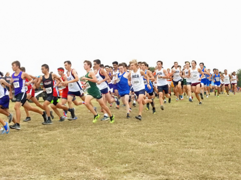A pack of MCA runners can be seen cautiously rounding the first corner of the course. Runners were closely packed together for the first quarter-mile of the race.
