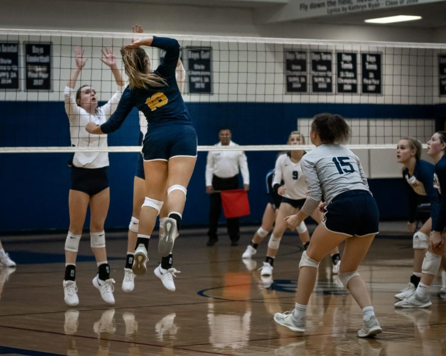 Senior Courtney Martin slams the ball over a Prince of Peace blocker.