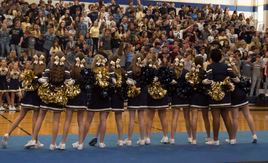 Students sing the Fight Song at the end of the pep rally