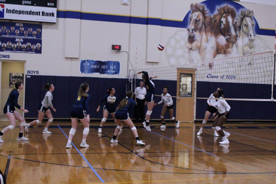 Junior Ava Grace Haggard hits the ball for the kill at the MCA Tournament of Champions