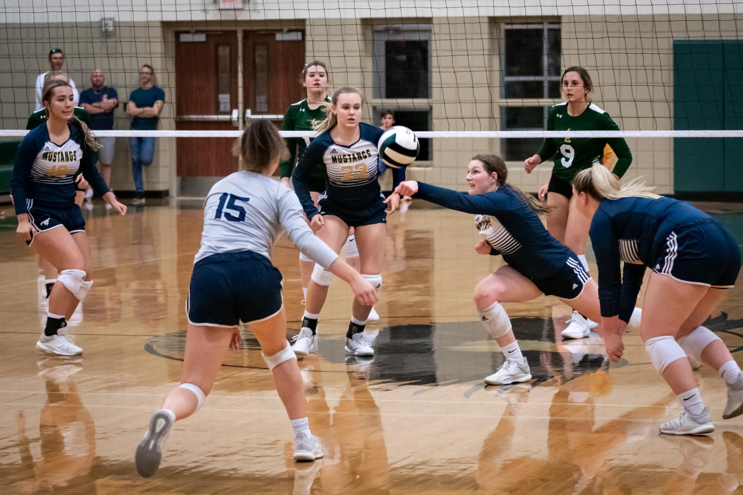 Senior captain Lauren Rose makes a dig to keep the ball in play.