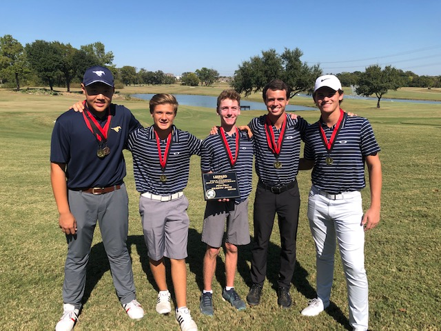 The Mustangs celebrate their first fall win of the season at The Course at Watters Creek.
