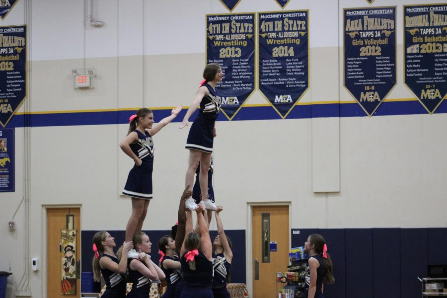The varsity cheerleaders show off their stunts during their performance.