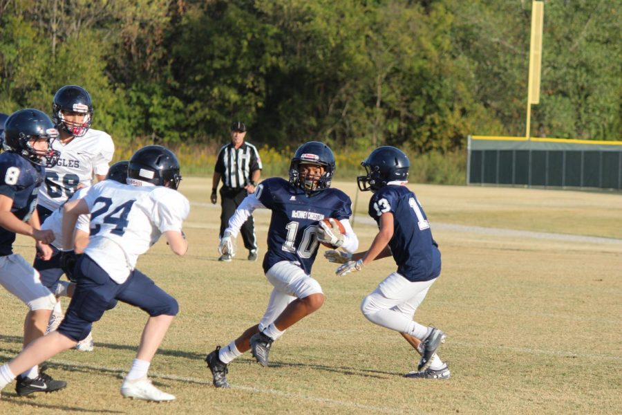 Seventh grader Aaron Grant turns the ball around the corner to gain yards for the Mustangs against ESD.