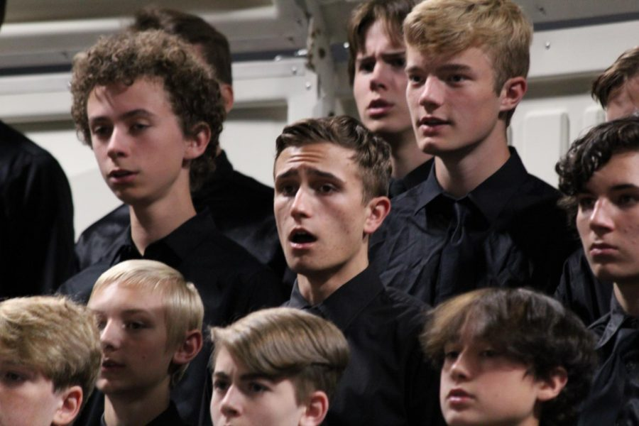 Junior, Bryce Atwood sings intently in the choir.