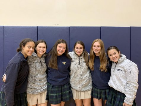 Middle School Girls, Sky Miller, Brooklyn Claudio, Lauren Etheredge, Ava Thompson, Tatum Goshgarian pose for a picture in their MCA sherpas and sweatshirts.