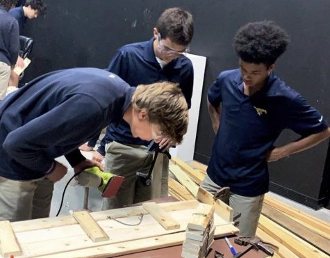 Theatre tech students constructing a desk for the one-act play.