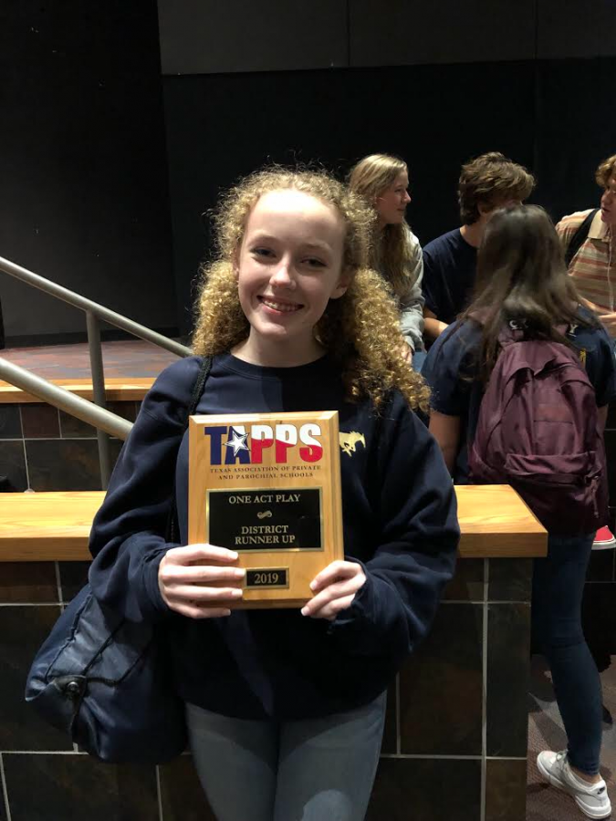 Birdie Martin holding a TAPPS award that was won at the One Act Play.