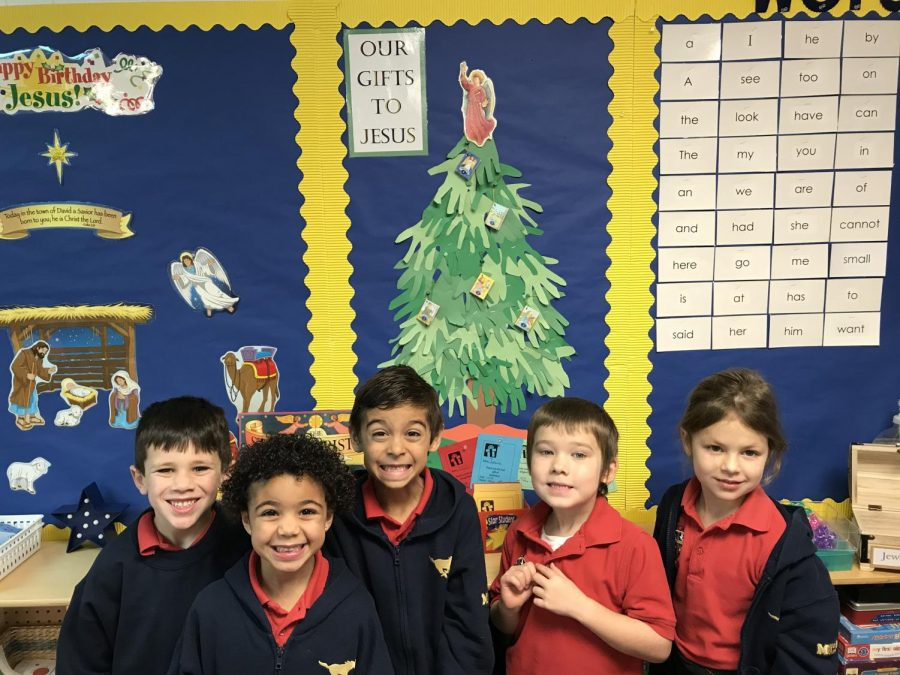 A group of Mrs. Stewart's kindergarten students take a picture in front of their